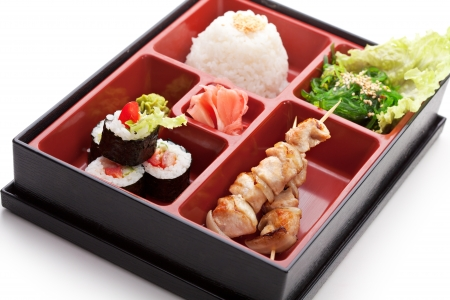 Japanese Meal in a Box (Bento) - Chuka Salad, Skewered Meat with Rice and Sushi Roll photo