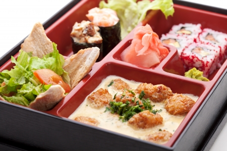 Japanese Meal in a Box (Bento) - Salad, Maki and Gunkan Sushi, Meats Ball photo