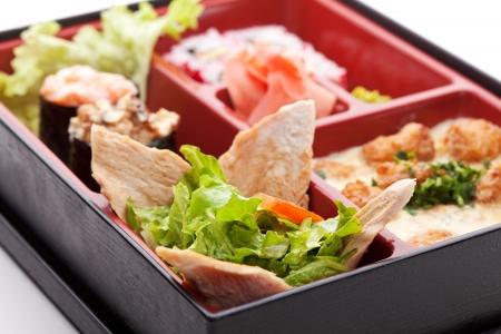 bento: Japanese Meal in a Box (Bento) - Salad, Maki and Gunkan Sushi, Meats Ball