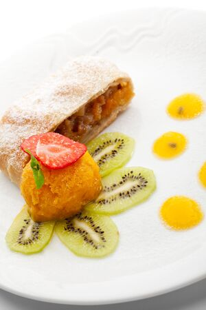 cream pie: Dessert - Apple Strudel Served with Fruits Ice Cream Stock Photo
