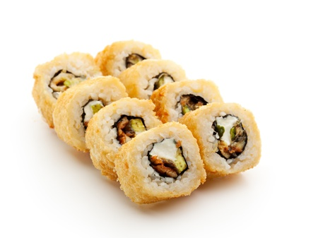 maki: Tempura Maki Sushi - Deep Fried Roll made of Smoked Eel, Avocado and Cream Cheese inside Stock Photo