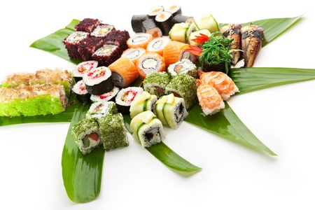 Sushi Set - Different Types of Maki Sushi and Nigiri Sushi. Served on Green Leaves photo