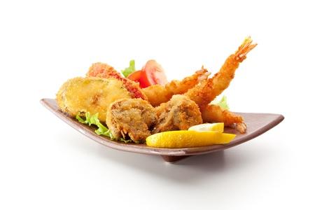 coated: Japanese Cuisine - Tempura Food: Deep Fried Shrimps, Vegetables and Mushrooms