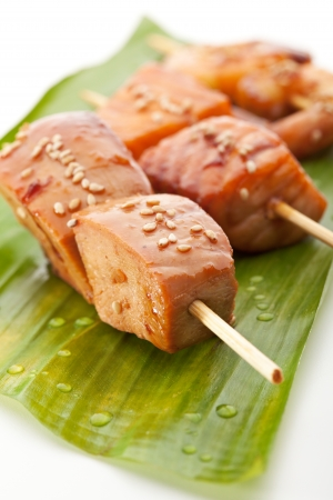 Grilled Shrimps, Salmon and Chicken Meat  Garnished on Green Banana Leaf photo
