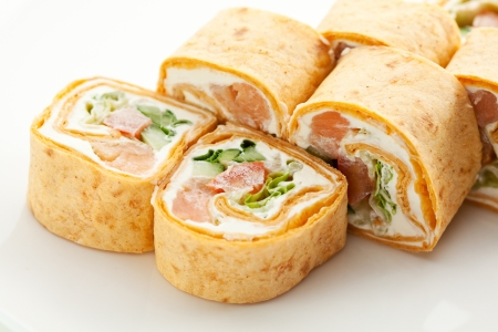 maki: Mexico Maki Sushi - Roll made of Smoked Salmon, Cream Cheese, Cucumber and Spring Onion inside. Tortilla outside