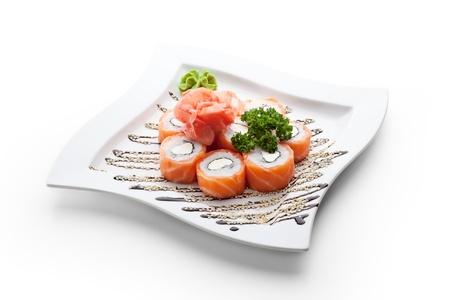 maki: Philadelphia Maki Sushi made of Philadelphia Cream Cheese inside, Fresh Raw Salmon outside. Garnished with Sauce Stock Photo