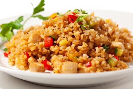 Chinese Cuisine - Gebakken rijst met groenten en vlees Stockfoto