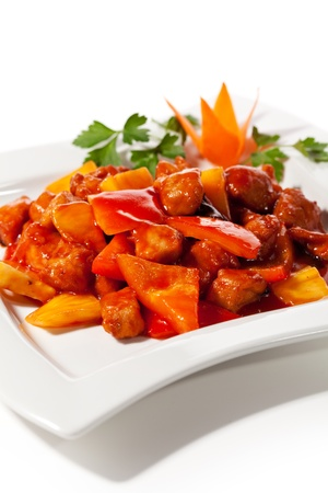 Chinese Cuisine - Pork with Pineapple Deep Fried in  Sour-Sweet Sauce Stock Photo