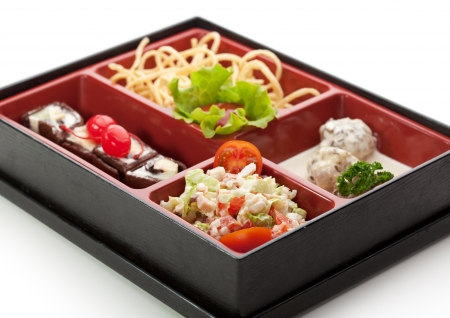 Meal in a Box (Bento) - Salad, Meat Balls, Potatoes, Dessert Maki Sushi photo