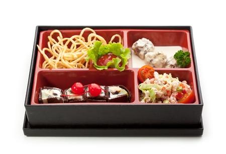 bento box: Meal in a Box (Bento) - Salad, Meat Balls, Potatoes, Dessert Maki Sushi Stock Photo