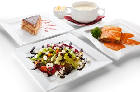 European Lunch - Greek Salad, Cheese Cream Soup, Lasagna Bolognese and Piece of Cake photo