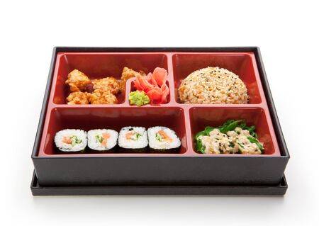 Japanese Meal in a Box (Bento) - Chuka Salad, Fried Rice with Veggies, Sushi Roll, Tori Karagi (breaded chicken) Stock Photo - 15221868