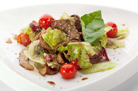 lowfat: Veal and Mushrooms Salad with Mixed Salad Leaves, Cherry Tomato and Balsamic Sauce Stock Photo