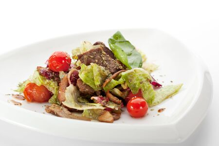 Veal and Mushrooms Salad with Mixed Salad Leaves, Cherry Tomato and Balsamic Sauce photo