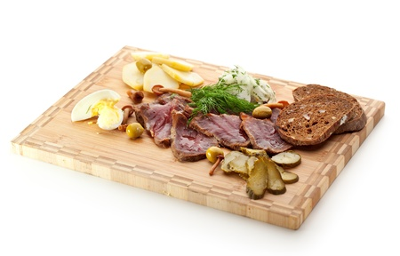 Roast Beef with Pickled Cucumber and Onions, Boiled Potato, Mushrooms and Toast photo