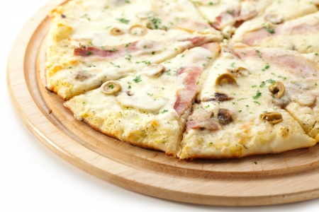 White Pizza made from Sour Cream Sauce, Mushrooms, Ham and Mozzarella Cheese photo