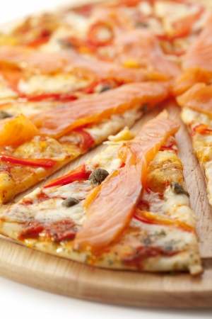 Pizza with Mozzarella, Salmon Slice, Black Olives and Vegetables photo