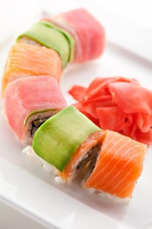 Rainbow Maki Sushi - Roll with Eel and Cream Cheese inside. Tuna, Salmon and Avocado outside photo