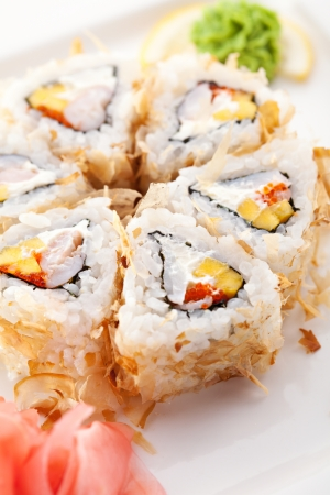 Salmon Skin Maki Sushi - Roll with Scallop, Cream Cheese and Pineapple inside. Grilled Salmon Skin outside