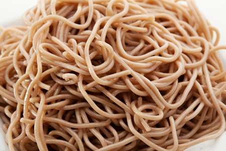 buckwheat noodle: Buckwheat Spaghetti Pasta on a White Plate Stock Photo