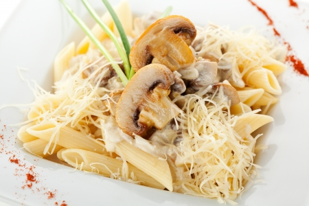 penne: Pasta Penne with Mushrooms and Parmesan Cheese. Garnished with Lettuce