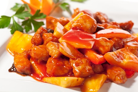Chinese Cuisine - Pork with Pineapple Deep Fried in  Sour-Sweet Sauce Imagens