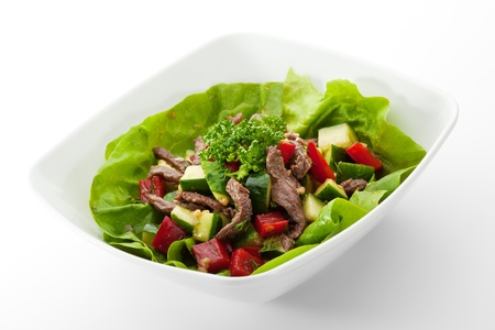 Salad with Veal and Vegetables on Salad Leaf photo