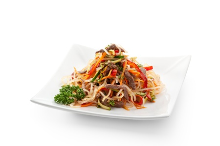 Salad with Rice Noodles, Fried Veal and Vegetables Stock Photo
