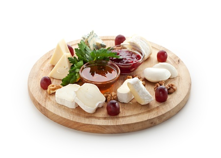 Cheese Platter with Grapes and Sweet Sauce Stock Photo