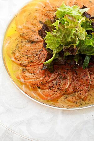 Appetizer - Salmon Carpaccio with Parmesan Cheese, Lime and Basil Leaf Stock Photo - 18743156