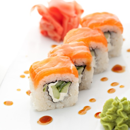 sushi roll: Roll with Cream Cheese and Cucumber inside. Salmon topped Stock Photo