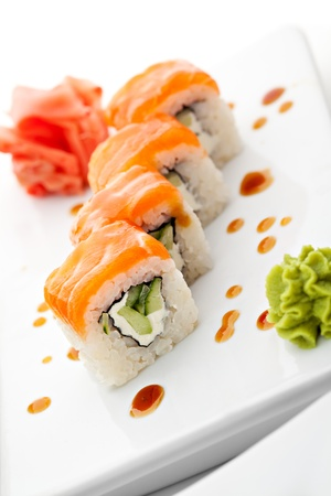 Roll with Cream Cheese and Cucumber inside. Salmon topped photo