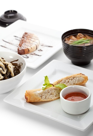 China Food - Salad, Soup with Pork and Udon, Chicken Spring Roll, Chocolate Dessert photo