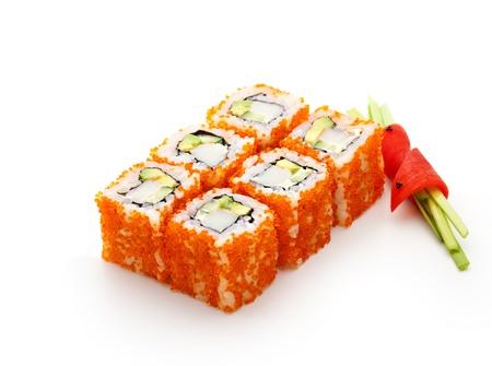 smelt: California Maki Sushi with Masago  - Roll made of Crab Meat, Avocado, Cucumber inside. Masago (smelt roe) outside Stock Photo