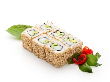maki: California Maki Sushi with Sesame - Roll made of Imitation Crab, Avocado, Cucumber, Japanese Mayonnaise inside. Sesame outside Stock Photo