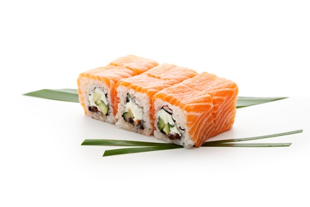 Roll with Cream Cheese, Salmon roe (ikura) and Cucumber inside. Salmon and outside. Served on Salad Leaf Stock Photo - 18743481