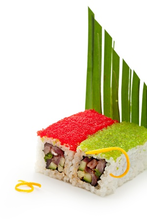 roe: Tobiko Spicy Maki Sushi - Hot Roll Topped with various type of Tobiko (flying fish roe). Tuna, Cucumber and Green Lettuce inside