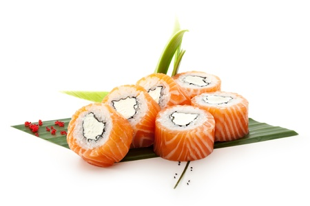 American Maki Sushi - Philadelphia Roll made of Cream Cheese  inside. Fresh Raw Salmon outside Stock Photo