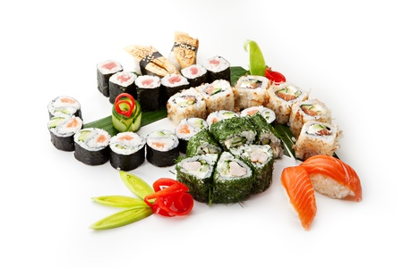 nigiri: Sushi Set - Different Types of Maki Sushi and Nigiri Sushi. Served on Green Leaves