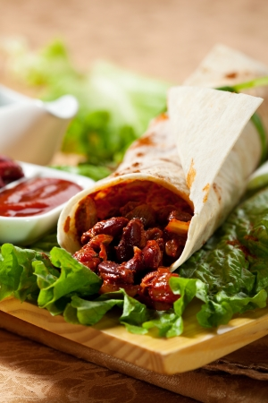 Burrito with Beef and Fresh Salad Leaves photo