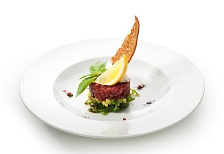 gourmet food: Tuna with Avocado Tartare with Lemon Slice Stock Photo