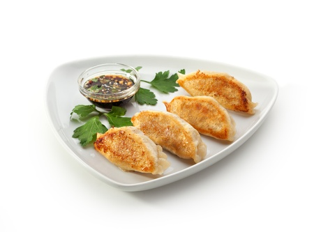 gyoza: Fried Dumpling - Gyoza. Garnished with Sauce and Parsley