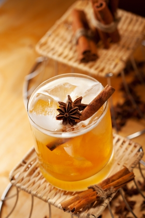 anise: Cocktail with Rum, Apple Juice and Cinnamon Syrup Stock Photo