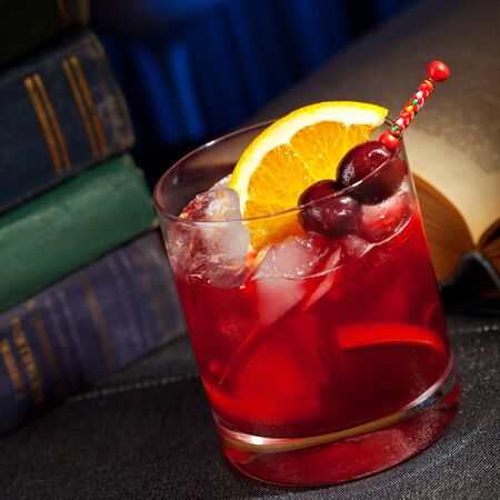 Bourbon Cocktail with Cherry, Bitter and Orange photo