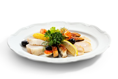 Fish Dish with Lemon, Parsley Leaf and Olives photo