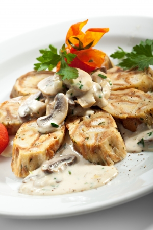 German Home-made Dumpling - Served as Sliced Rolls with Mushrooms and Cream Sauce photo
