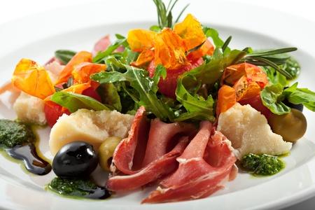 ruccola: European Plate - Serrano Ham, Parmesan, Vegetables, Ruccola and Baked Tomato Stock Photo