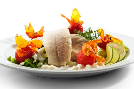 Trout Fillet with Baked Tomato, Salad Leaves and Potato photo