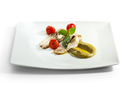 Baked Fillet of Seabass with Cherry Tomato, Zucchini and Basil Cream Sauce photo