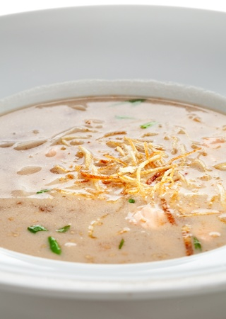 Thai Dishes - Spicy Seafood Soup with Noodles and Salmon Slice photo